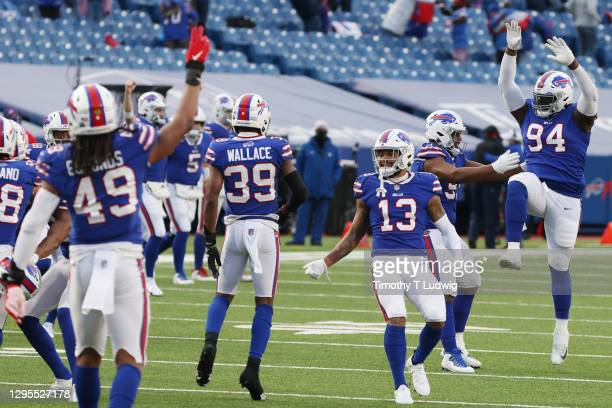The Buffalo Bills celebrate a 27-24 win during the second half of the AFC Wild Card playoff game against the Indianapolis Colts at Bills Stadium on...