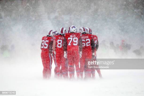 The Buffalo Bills offense huddles during the third quarter against the Indianapolis Colts on December 10 2017 at New Era Field in Orchard Park New...