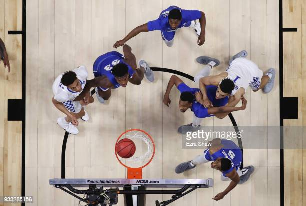The Buffalo Bulls and the Kentucky Wildcats watch the ball in the second round of the 2018 NCAA Men's Basketball Tournament at Taco Bell Arena on...
