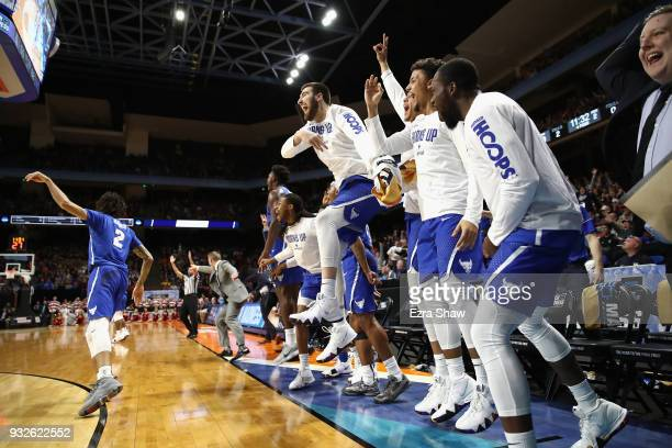 The Buffalo Bulls bench celebrates a three point basket in the second half against the Arizona Wildcats during the first round of the 2018 NCAA Men's...