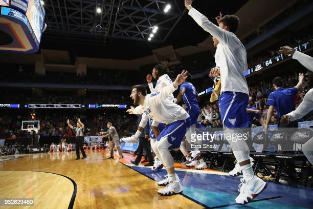 The Buffalo Bulls bench celebrates in the second half against the Arizona Wildcats during the first round of the 2018 NCAA Men's Basketball...