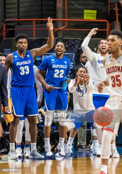 The Buffalo Bulls bench gets excited over a series of 3 point baskets during the NCAA Division I Men's Championship First Round game between the...