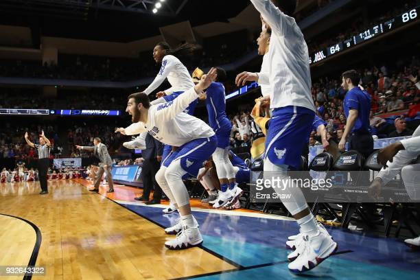 The Buffalo Bulls bench reacts in the second half against the Arizona Wildcats during the first round of the 2018 NCAA Men's Basketball Tournament at...