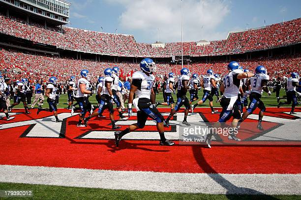 The Buffalo Bulls run on to the field prior to the start of the game against the Ohio State Buckeyes on August 31 2013 at Ohio Stadium in Columbus...