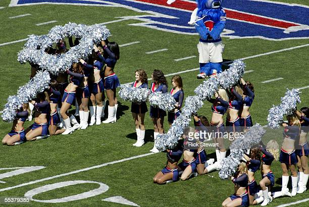 The Buffalo Jills Cheerleaders spell out 911 during pregame ceremonies before the game between the Houston Texans and the Buffalo Bills on September...