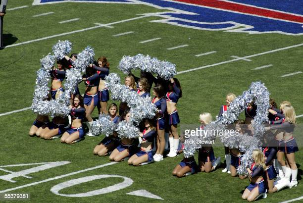 The Buffalo Jills Cheerleaders spell out USA during pregame ceremonies before the game between the Houston Texans and the Buffalo Bills on September...