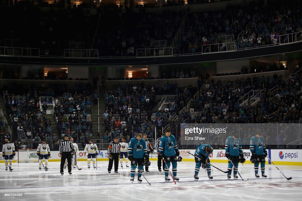 The Buffalo Sabres and the San Jose Sharks stand for a moment of silence for all the victims of the North Bay Fires before their game at SAP Center on October 12, 2017 in San Jose, California.