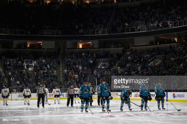 The Buffalo Sabres and the San Jose Sharks stand for a moment of silence for all the victims of the North Bay Fires before their game at SAP Center...