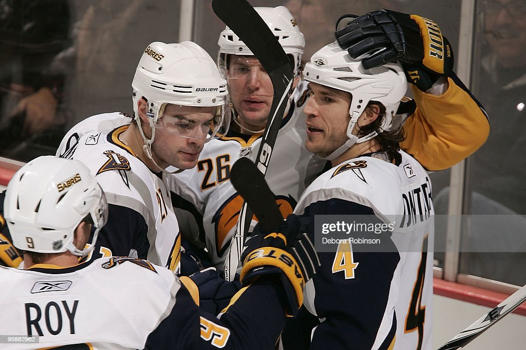 The Buffalo Sabres celebrate a second period goal by Steve Montador #4 during the game against the Anaheim Ducks on January 19, 2010 at Honda Center in Anaheim, California.