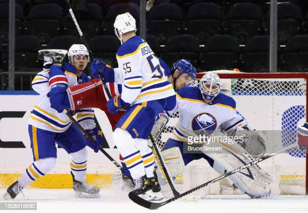 The Buffalo Sabres defend against Chris Kreider of the New York Rangers during the first period at Madison Square Garden on March 22, 2021 in New...