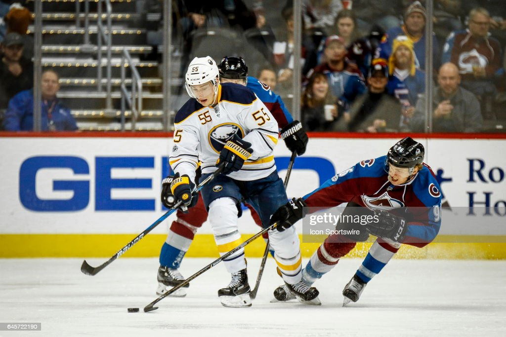 The Buffalo Sabres' Rasmus Ristolainen #55 goes after a loose puck in front of the Colorado Avalanche's Mikko Rantanen #96 during their NHL regular season game on February 25, 2017, at the Pepsi in Denver, Co. The Avalanche won the game 5-3.