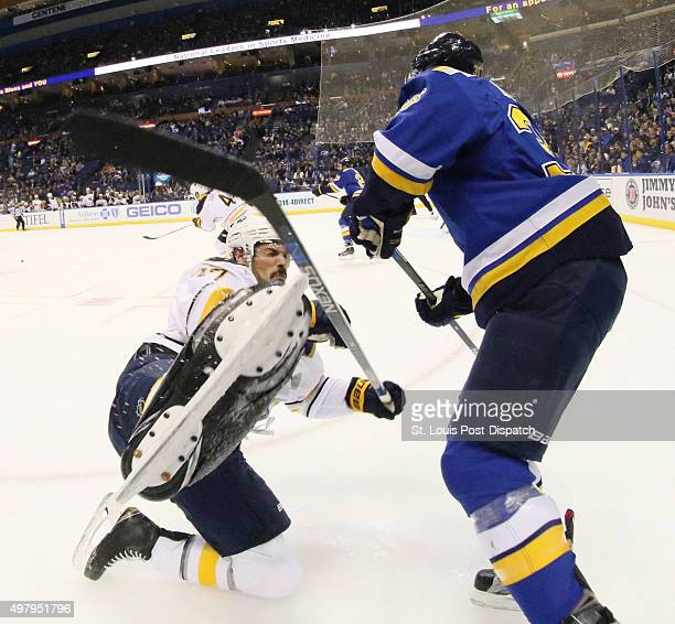The Buffalo Sabres' Zach Bogosian left is knocked down by the St Louis Blues' Troy Brouwer in the first period on Thursday Nov 19 at the Scottrade...