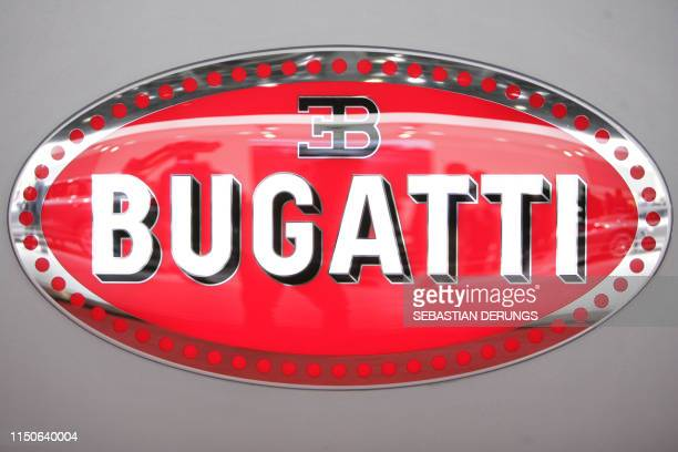The Bugatti logo on show at the carmaker's booth on March 2, 2011 during the preview day ahead of the opening of the Geneva Motor Show in Geneva .The...