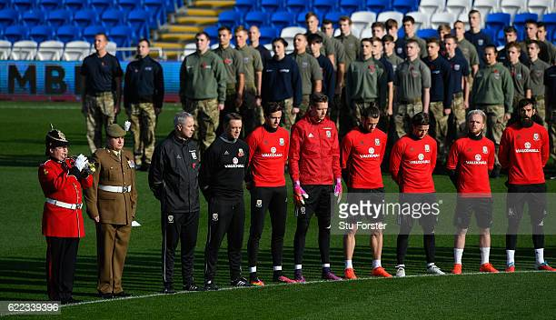 The bugle player plays the last post as Wales players observe a two minute silence to mark Remembrance Day before Wales training prior to the FIFA...
