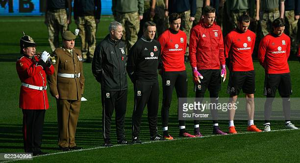 The bugle player plays the last post as Wales players observe a two minute silence to mark November 11th before Wales training prior to the FIFA 2018...