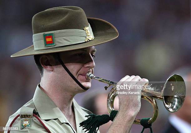 The Bugle player plays the last post before the start of the round seven NRL match between the Brisbane Broncos and the Parramatta Eels at Suncorp...