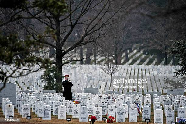 The bugler plays taps during the service for US Army Sgt Aaron X Wittman at Arlington National Cemetery on Friday February 8 2013 28 Sgt Wittman was...
