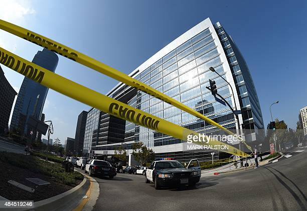 The building in Century City is secured as the LAPD Hazmat and Bomb Squads prepare to investigate a suspicious package found in the mail room of the...