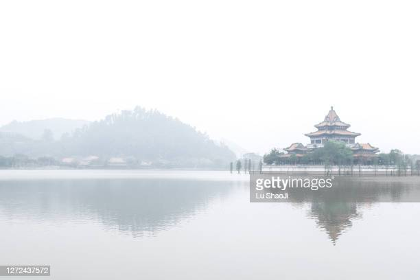 the building in the style of a chinese palace in the middle of the lake. - tradition stock pictures, royalty-free photos & images