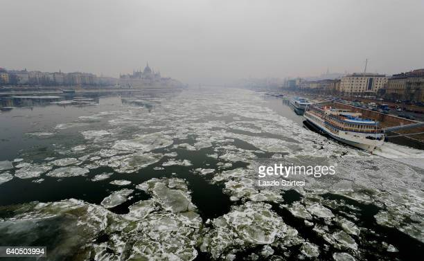 The building of Parliament and the Chainbridge over the Danube River covered in smog seen from Margaret Bridge on January 31 2017 in Budapest Hungary...