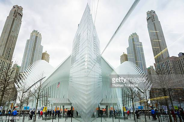 New York United States of America February 25 The building of the 9/11 Museum and the Oculus Station in Manhattan reflected in a window on February...