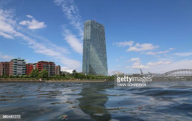 The building of the European Central Bank is pictured in the background of the river Main, in Frankfurt am Main, Germany, on June 21, 2018.