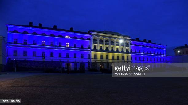 The building of the Finnish Ministry of Foreign Affairs is illuminated in the colors of the flag of Sweden to remember the victims of the Stockholm...