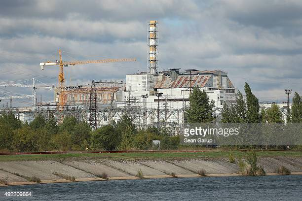 The building that on its left side houses the remains of reactor number four stands at the site of the former Chernobyl nuclear power plant on...