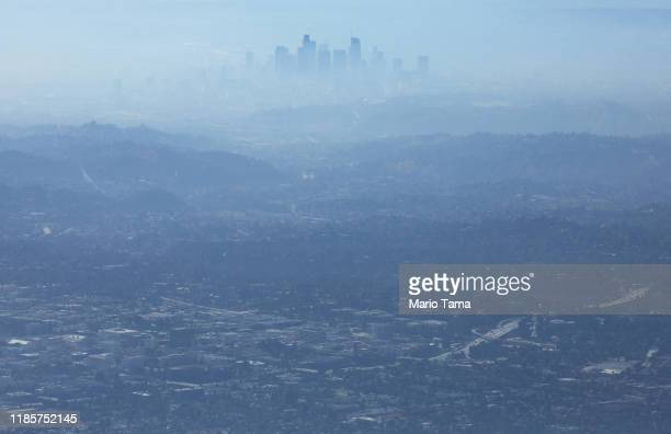 The buildings of downtown Los Angeles are partially obscured at midday on November 5, 2019 as seen from Pasadena, California. The air quality for...