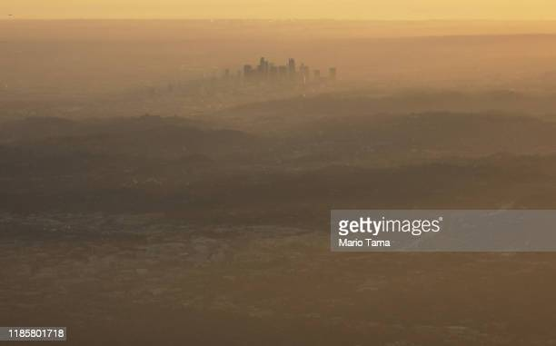 The buildings of downtown Los Angeles are partially obscured in the late afternoon on November 5, 2019 as seen from Pasadena, California. The air...