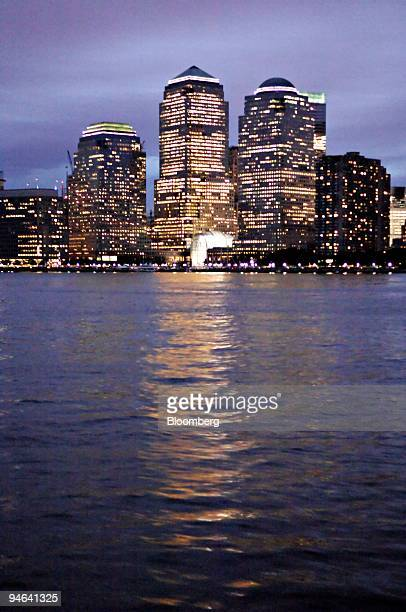 The buildings of the World Financial Center in the downtown financial district of New York are reflected in the Hudson River on Monday Aug 20 2007