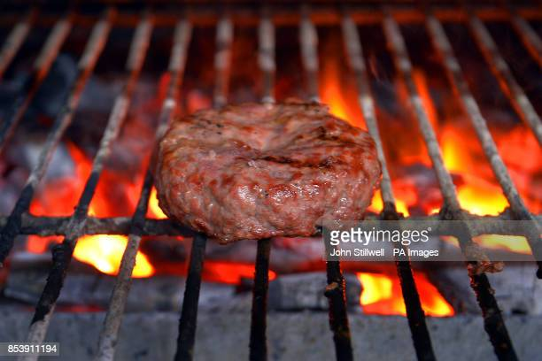 The Bukowski Burger bar in Boxpark Shoreditch east London which serves a Fat Gringo burger the beef patty is cooked in a chargrill oven before being...