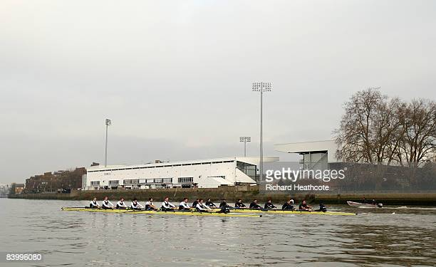 The Bull and Bear crews row past Craven Cottage, Fulham FC's stadium, during the Oxford University Boat Club Trial Eight race on the River Thames on...