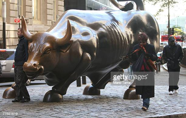The bull scupture is seen near Wall Street October 29 2007 in New York City Merrill Lynch CEO Stan O'Neal is reportedly close to resigning following...