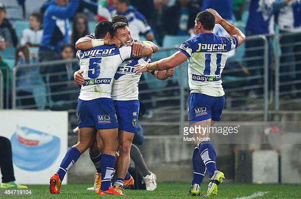 The Bulldogs celebrate a try by Sam Perrett during the round 24 NRL match between the South Sydney Rabbitohs and the Canterbury Bulldogs at ANZ...
