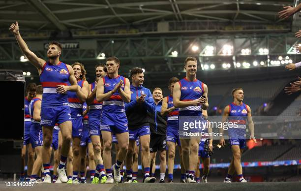 The Bulldogs celebrate after they defeated the Saints during the round 10 AFL match between the Western Bulldogs and the St Kilda Saints at Marvel...