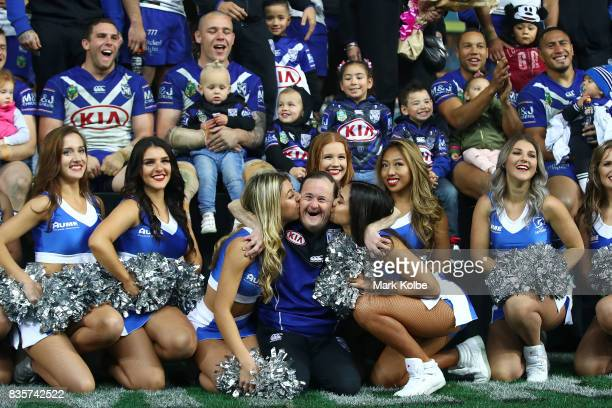 The Bulldogs club members cheer on stage as Bulldogs team assistant Sean White is given a kiss by two cheergirls after a presentation to the players...