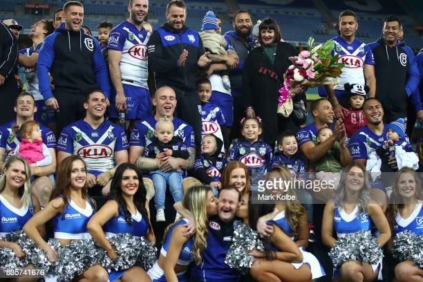 The Bulldogs club members pose on stage after a presentation to the players leaving the club at the end of the season after the round 24 NRL match...