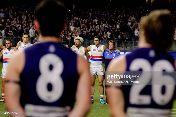 The Bulldogs line up for the ANZAC proceedings during the round five AFL match between the Fremantle Dockers and the Western Bulldogs at Optus...