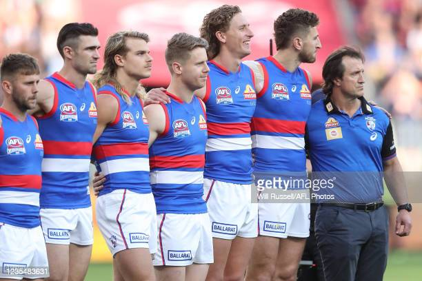 The Bulldogs line up for the Australian National Anthem during the 2021 Toyota AFL Grand Final match between the Melbourne Demons and the Western...