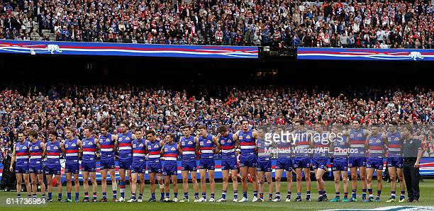 The Bulldogs line up for the national anthem during the 2016 Toyota AFL Grand Final match between the Sydney Swans and the Western Bulldogs at the...