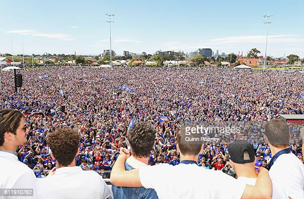 The Bulldogs look out to the crowd during the Western Bulldogs AFL Grand Final celebrations at Whitten Oval on October 2 2016 in Melbourne Australia...