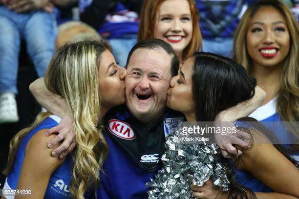The Bulldogs team assistant Sean White is given a kiss as he poses with cheergirls after a presentation to the players leaving the club at the end of...
