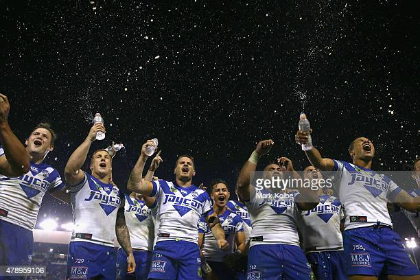 The Bulldogs team sing their team song in front of the crowd on the hill as they celebrate victory during the round 16 NRL match between the...
