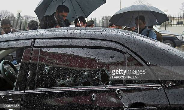 The bulledriddled car of Pakistani Minorities Minister Shahbaz Bhatti is seen at a hospital compound following an attack in Islamabad on March 2 2011...