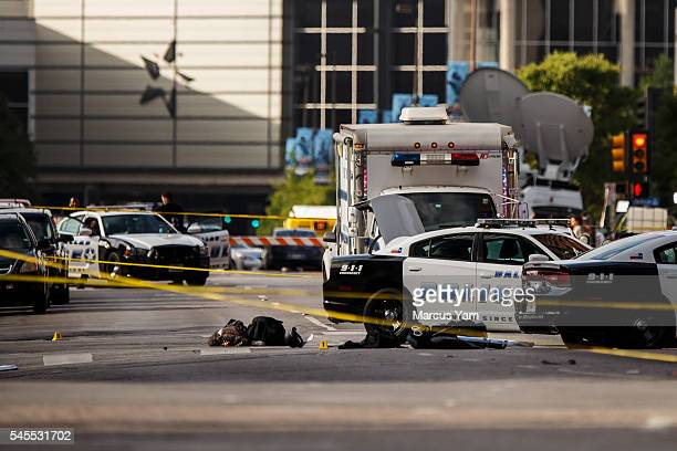 The bullet casings police gear can be seen laid out on Lamar Street where a sniper unleashed a barrage of bullets killing 5 police officers and...