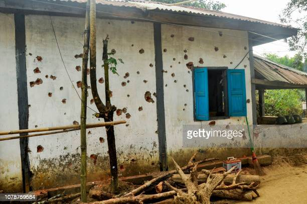 The bullet riddle wall of Goke Pi police station is seen in Buthidaung on January 7 2019 Myanmar has called on its military to launch operations...