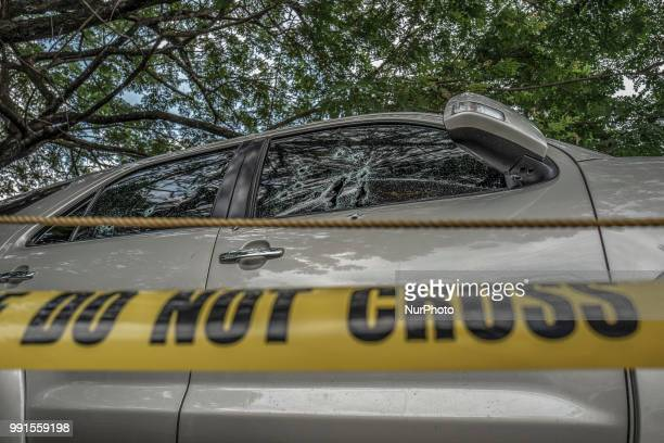 The bullet riddled vehicle of General Tinio Mayor Ferdinand Bote who was assassinated by unidentified gunmen on motorcycles is seen parked in a...