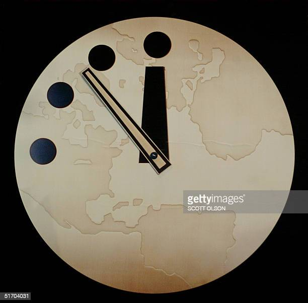 The Bulletin of Atomic Scientist's Doomsday Clock reads seven minutes to midnight after being adjusted two minutes closer 27 February 2002 in Chicago...