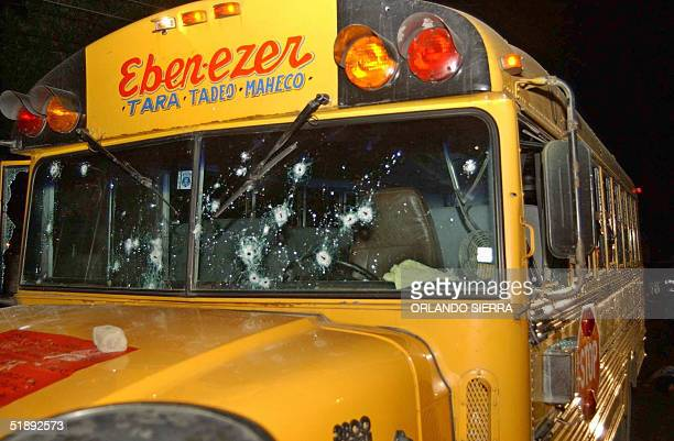 The bulletriddled interurban bus making the EbenezerSan Pedro route attacked early 24 December 2004 remains in the Chamelecon sector south of San...